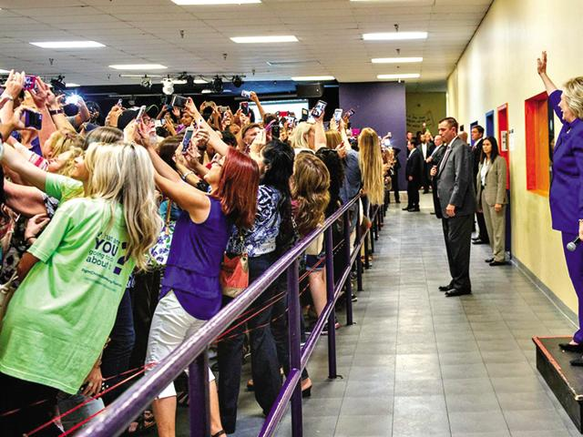 No looking back: This odd-looking photograph shows the crowd taking a selfie with Hillary Clinton