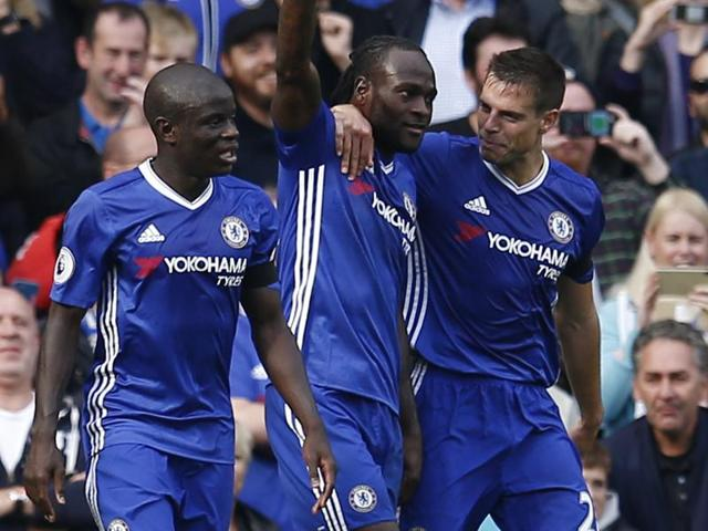Chelsea's Victor Moses celebrates scoring their third goal with David Luiz and team mates.
