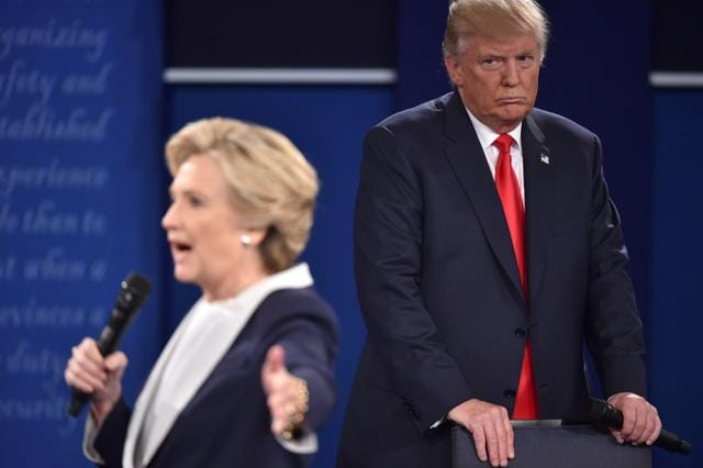 Donald Trump listens to Democratic presidential candidate Hillary Clinton during the second presidential debate at Washington University in St. Louis, Missouri.