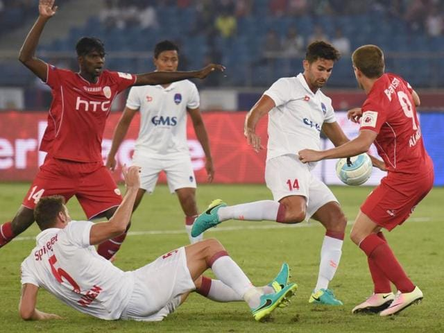 Delhi Dynamos FC (white Jersey) and North East United FC players in action during ISL 2016.