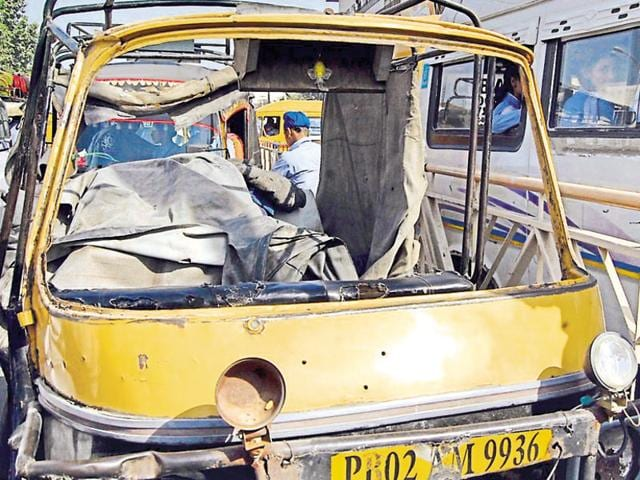 The damaged overloaded auto rickshaw that met with an accident near Rego Bridge on Friday.