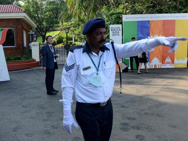 Indian security personnel stand guard outside the Taj Exocita hotel, the venue for the BRICS Summit, in Goa on Saturday.