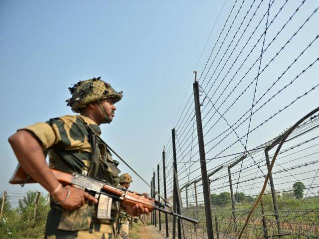 A Border Security Force (BSF) soldier takes up position at an outpost along a fence at the India-Pakistan border in RS Pora, southwest of Jammu.
