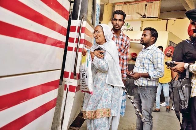 A senior citizen boarding a bus at ISBT in Jalandhar on Friday.