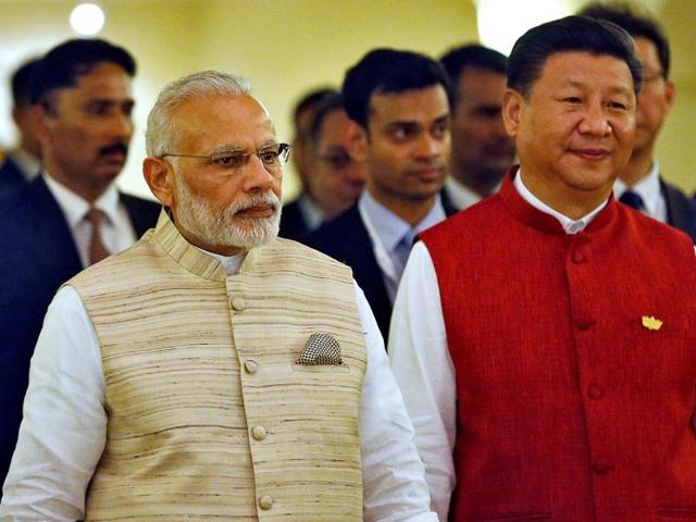 Prime Minister Narendra Modi and Chinese President Xi Jinping arrive for a photo opportunity ahead of BRICS Summit in Benaulim, Goa, on Saturday.