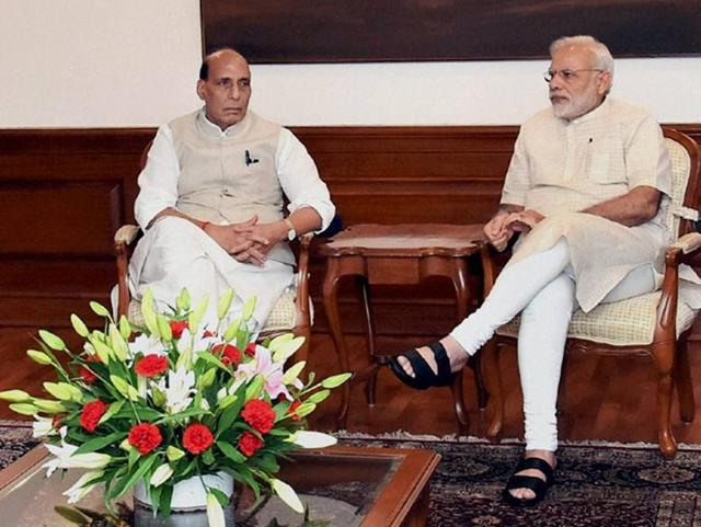 Prime Minister Narendra Modi interacts with home minister Rajnath Singh during a high-level in the wake of Uri terror attack.