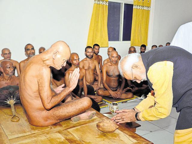 Prime Minister Narendra Modi seeks blessings of Acharya Vidyasagar at Habibganj Digambar Jain temple in Bhopal on Friday.
