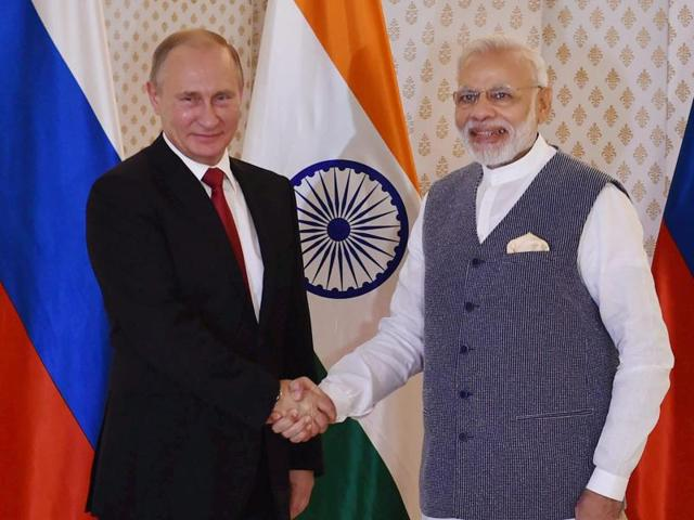 Russian President Vladimir Putin being welcomed by Prime Minister Narendra Modi ahead of 17th India-Russia annual summit meet in Benaulim, Goa on Saturday.