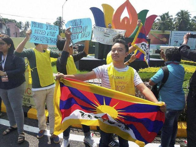Tibetans display placards in Margao, Goa, during protest against China for the freedom of Tibet.