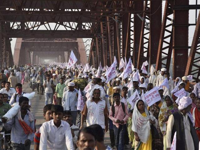 Baba Jai Gurudev supporters crossing the crowded Rajghat Bridge for a meeting in Varanasi on Saturday.