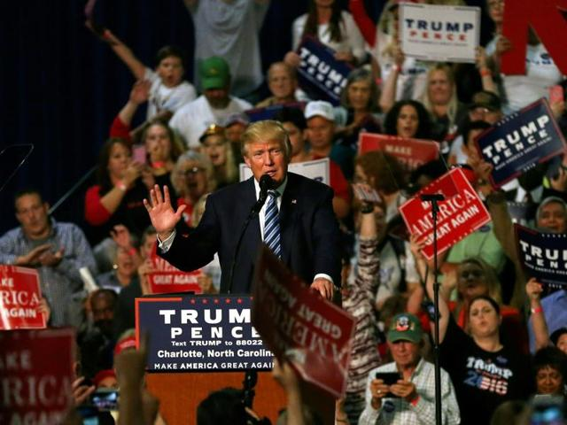Republican presidential nominee Donald Trump addresses the crowd at his rally at the Convention Center in Charlotte, North Carolina on October 14, 2016.