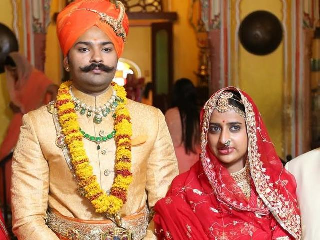 Karni Singh Sodha and his wife Padmini Rathore pose for a photo after the wedding.