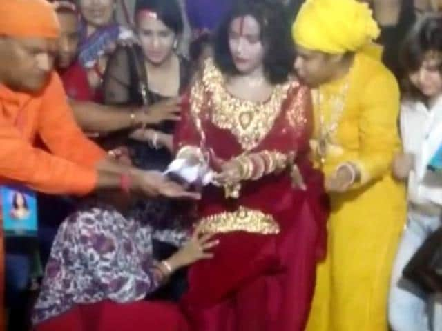 Self-styled godwoman Radhe Maa offers prayers at Har-ki-Pauri in Haridwar.