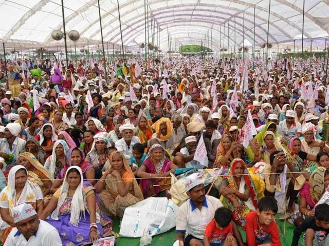 A gathering of  Jai Gurudev followers at Domri village on Sunday, a day after a stampede  broke out during a religious gathering  in which 25 people lost their lives.