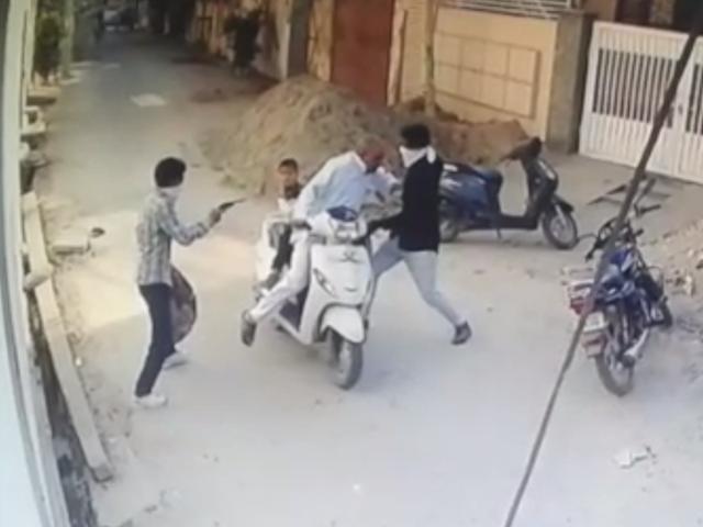 CCTV grab of the men robbing off the elderly man.