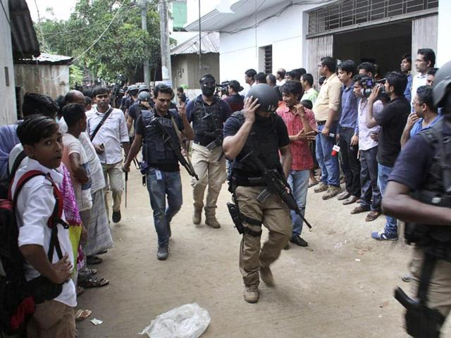 Bangladesh's Special Weapons and Tactics (SWAT) policemen return after a raid in Gazipur in Bangladesh on Oct. 8, 2016.