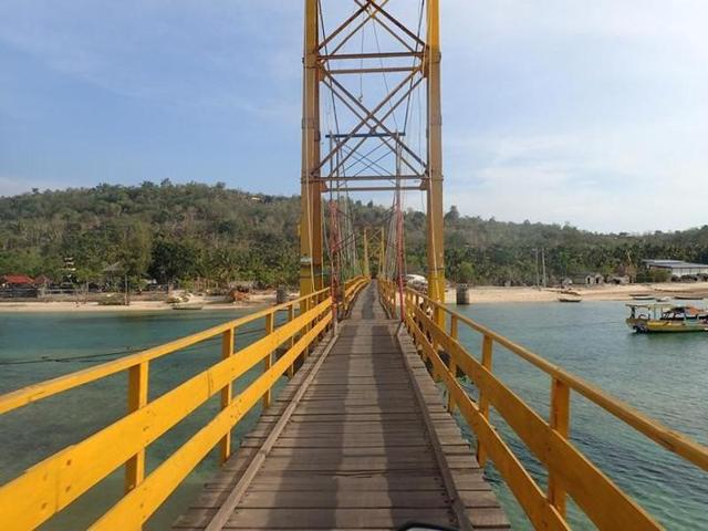 The 'Yellow Bridge', which connects Nusa Lembongan and Nusa Ceningan, two islands located east of the resort island of Bali, Indonesia.
