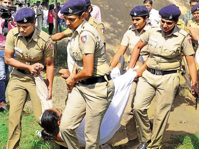 A woman protestor being removed from outside Punjab CM Parkash Singh Badal's residence in Chandigarh on Saturday.