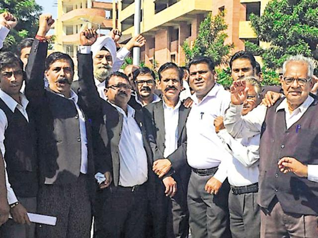 Lawyers protesting outside the district courts, Sector 43, in Chandigarh on Saturday.