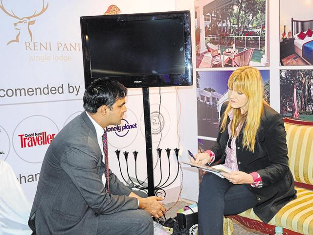 A foreign delegate at a kiosk set up for the third MP Travel Mart at a Bhopal hotel on Saturday.