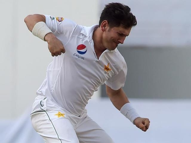 Pakistani spinner Yasir Shah celebrates after taking the wicket of West Indies captain Jason Holder.