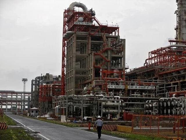 An employee walks inside the premises of an oil refinery of Essar Oil, which runs India's second biggest private sector refinery, in Vadinar in Gujarat.