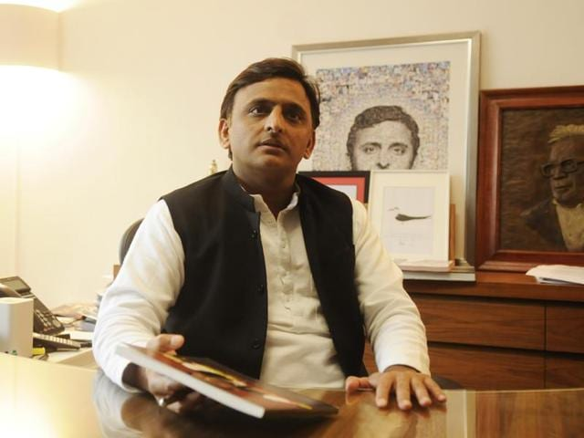 Uttar Pradesh chief minister Akhilesh Yadav interacts with journalists at his residence in Lucknow.
