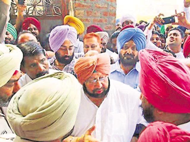 Punjab  Congress chief Capt Amarinder Singh outside the Kotli Surat Malhi police station in Batala on Wednesday.