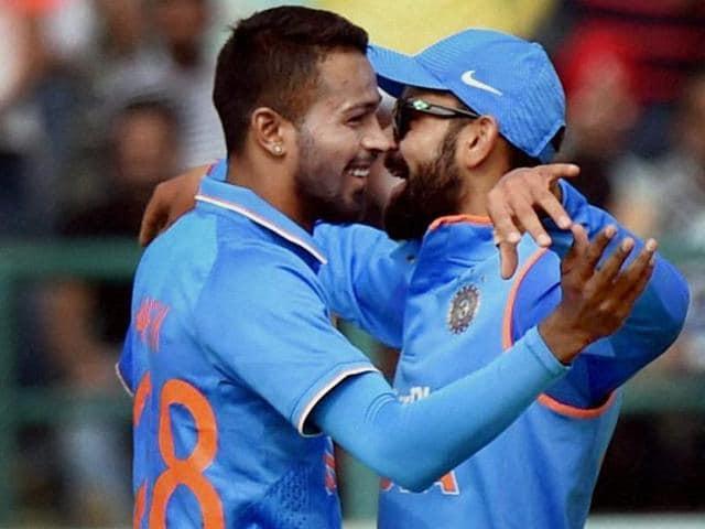 India's Hardik Pandya celebrates with team mate Virat Kohli the dismissal of New Zealand batsman Luke Ronchi.