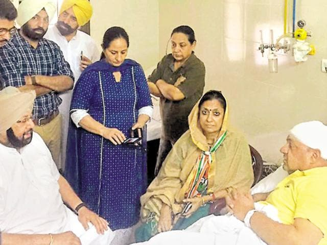 Punjab Congress chief Capt Amarinder and party's state in-charge Asha Kumari enquiring about the well-being of Ludhiana Congress chief Gurpreet Gogi at DMCH on Saturday..