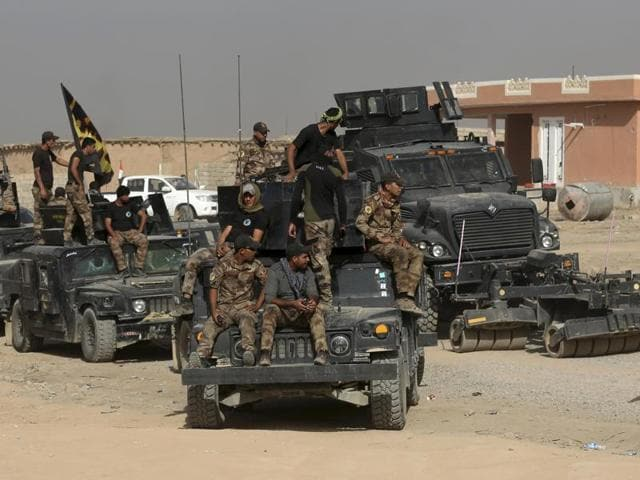 Iraq's elite counterterrorism forces gather ahead of an operation to retake the Islamic State-held city of Mosul on Saturday.