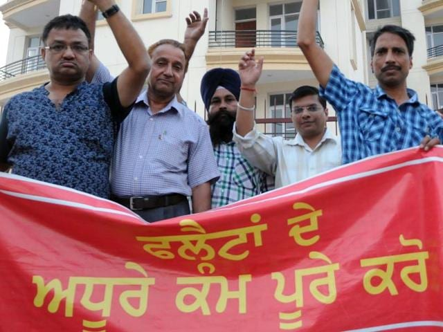 Flat allottees holding a protest in Patiala on Saturday.