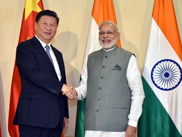 Prime Minister Narendra Modi shakes hands with Chinese President Xi Jinping ahead of the BRICS Summit, in Goa.