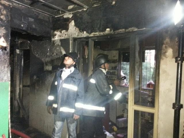 Fire Brigade personnel at the spot where the fire broke out.