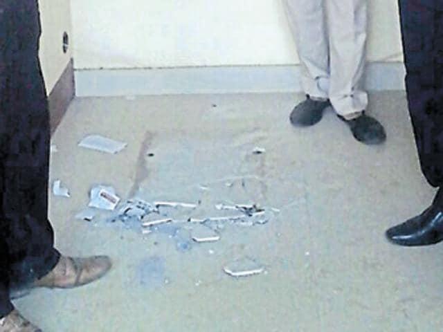 Rs 18-lakh heist,heist,ATM uprooted