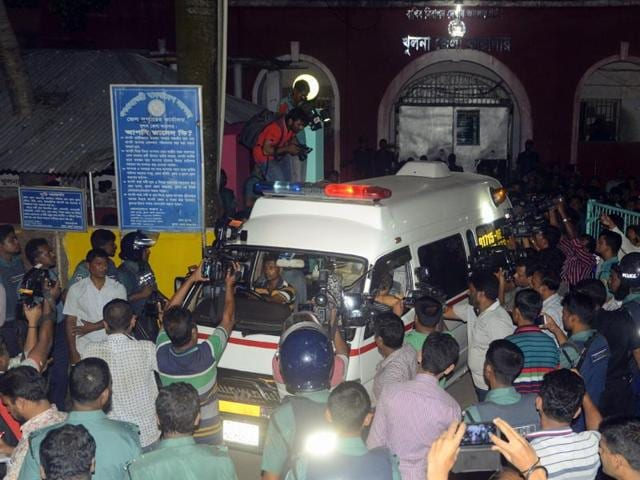 An ambulance leaves Khulna Jail carrying body of Asadul Islam after he was executed in Khulna.
