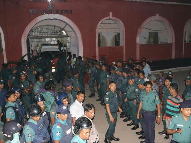 Bangladeshi prison security personnel stand guard in front of Khulna jail on Sunday.