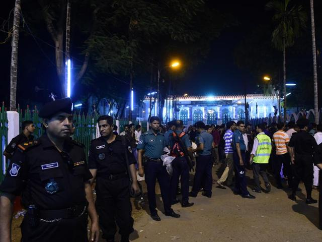 Bangladeshi security personnel stand guard after a small bomb exploded outside Bangladesh capital's main Shia religious site in Dhaka on October 24, 2015.