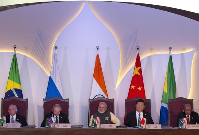 Leaders of BRICS nations, from left, Brazilian President Michel Temer, Russian President Vladimir Putin, Prime Minister Narendra Modi, Chinese President Xi Jinping and South African President Jacob Zuma listen to the BRICS Business Council report during the summit in Goa.