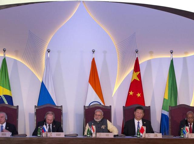 Leaders of BRICS nations, from left, Brazilian President Michel Temer, Russian President Vladimir Putin, Indian Prime Minister Narendra Modi, Chinese President Xi Jinping and South African President Jacob Zuma listen to the BRICS Business Council report during the summit in Goa.