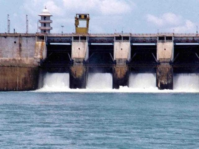 This file picture from September 2002 shows Cauvery river water being released from the Kabini Dam at Heggadadevankote province. Farmers' groups and opposition parties have embarked on a campaign to protest the sharing of river waters with the neighbouring state of Tamil Nadu after a Supreme Court order ordered the Karnataka state government to release 1.25 billion cubic feet of water from its four reservoirs each day until a final decision on this issue was taken by a federal body, the Cauvery River Authority.