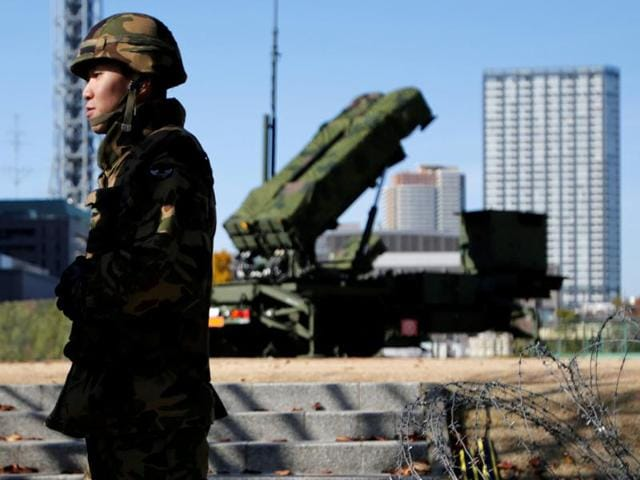 A Japan self-defense forces soldier guards near a unit of Patriot Advanced Capability-3 (PAC-3) missiles at the Defense Ministry in Tokyo.
