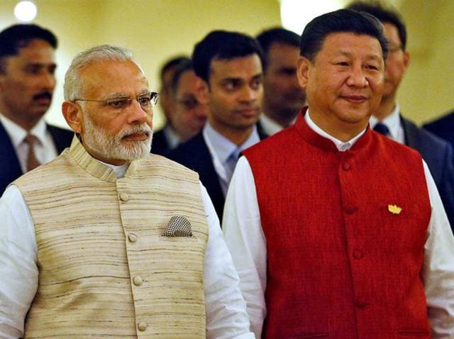 Prime Minister Narendra Modi and Chinese President Xi Jinping arrive for a photo opportunity ahead of the BRICS Summit in Benaulim, Goa.