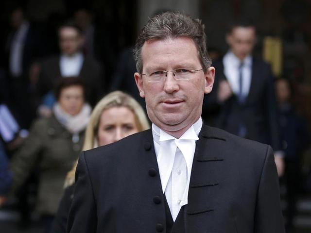 Britain's attorney general Jeremy Wright returns to the high court in London, Britain, during a legal challenge to force the British government to seek parliamentary approval before starting the formal process of leaving the European Union.