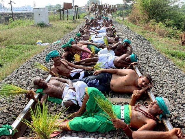 Farmers and opposition parties members staging a rail roko agitation at Trichy on Monday over the Cauvery water issue.
