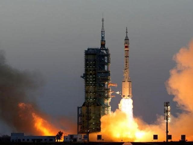 Shenzhou-11 manned spacecraft carrying astronauts Jing Haipeng and Chen Dong blasts off from the launchpad in Jiuquan, China, October 17, 2016. China Daily/via REUTERS