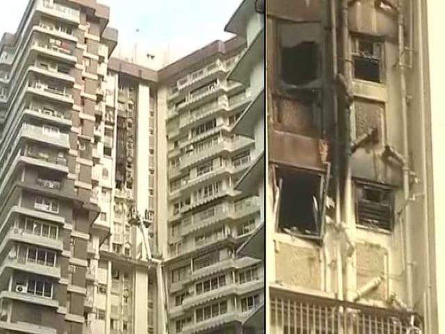 Watch fire at mumbai residential complex two dead for Jolly maker apartments cuffe parade