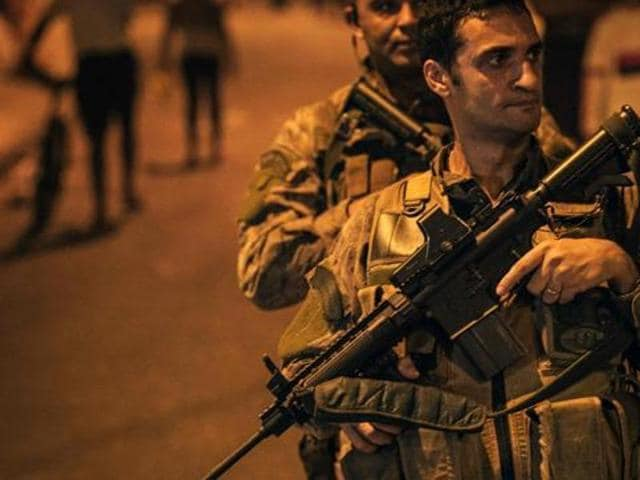 Officers of the special police unit (BOPE) patrol the street following clashes between drug dealer in Rio de Janeiro. Drug cartels often leave the dismembered bodies of victims on roadsides in Mexico.