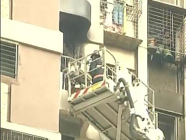 Family members of Shekhar Bajaj, in whose house a fire broke out, being evacuated. The blaze began on the 21st floor of the Maker Towers in Nariman Point, Mumbai, on October 17, 2016.