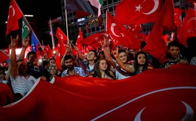 A file photo of people shouting slogans and waving Turkish national flags following the July 15 coup attempt in Ankara, Turkey.